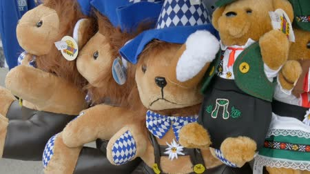 pretzel : September 17, 2017 - Oktoberfest, Munich, Germany: Large number of souvenir bear cubs of oktoberfest characters. World Beer Festival in Bavaria Stock Footage