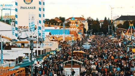 pretzel : September 17, 2017 - Oktoberfest, Munich, Germany:View of the huge crowd of people walking around the Oktoberfest in national bavarian suits, on Theresienwiese, top view