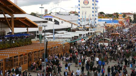 literário : September 17, 2017 - Oktoberfest, Munich, Germany: view of the huge crowd of people walking around the Oktoberfest in national bavarian suits,The famed folk festival in the world
