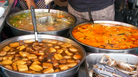 wok food : Counter with variety of Thai food. Meat, soups, salads. Asian street food Stock Footage