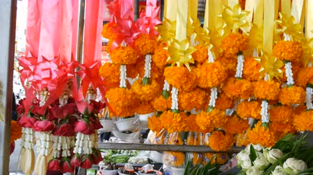 fragrances : Beautiful yellow Thai flowers on colored tapes. Exotic flowers of Asia for offering Buddha