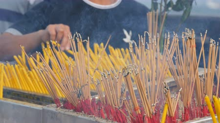 dead wood : Large number of yellow sticks of good luck smoke in front of the altar. Religion Buddhism in Asian countries