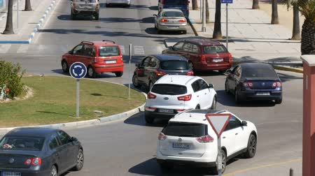 nanpu : September 26 - 2017, La Linea, Spain: Many cars on a roundabout turn on the road Stock Footage