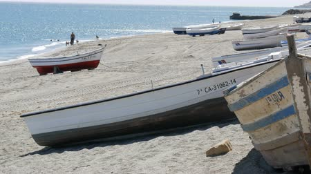 mooring : September 26 - 2017, La Linea, Spain: Old wooden boats on a shore of the Mediterranean Sea