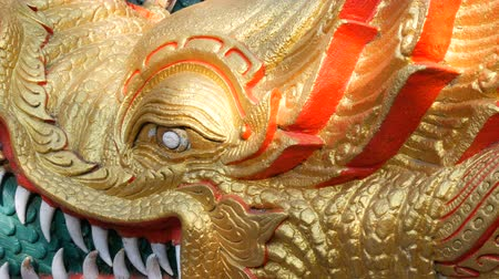 thai kültür : Magnificent golden dragons frame the steps to the statue of the golden big Buddha. Dragons near entrance in Big Golden Buddha statue on Pratumnak Hill in Pattaya, Thailand Stok Video