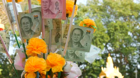 pile of money : Thai money baht. Banknotes in nominal value of 20 baht. Paper money on Buddha statue background Stock Footage