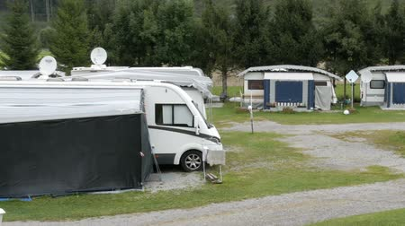 caravan : September 8, 2017 - Unterterl, Austria: Parking camping in which many trailers and in which people live. Picturesque Austrian valley on which there is a campsite