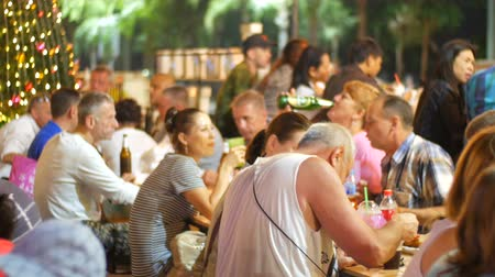 wok food : PATTAYA, THAILAND - DECEMBER 23, 2017: People are dining on the night market Joptien in open air
