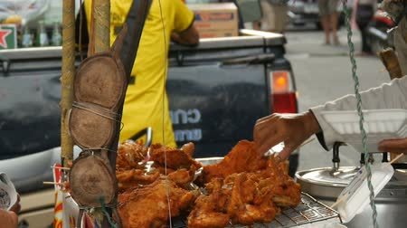 rántott : PATTAYA, THAILAND - DECEMBER 17, 2017: Street food of Thailand. Fried chicken pieces in batter.The seller on the street is selling an exotic dish