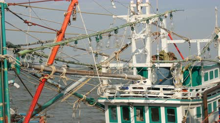 industrial fishing : Lamps on boat that catches squid. Old wooden boat on the dock Stock Footage