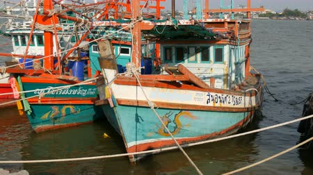 industrial fishing : PATTAYA, THAILAND - DECEMBER 25, 2017: A large number of wooden fishing boats are moored on quay