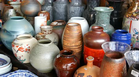 cserépedény : Various porcelain and clay jugs on the counter of store
