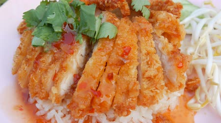tempura : Thai food. Rice with pea pods and fried crispy chicken on breading