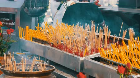 taoism : Large number of yellow sticks of good luck smoke in front of the altar. Religion Buddhism in Asian countries