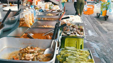 vietnami : PATTAYA, THAILAND - February 7, 2018: Counter with variety of Thai food. Meat, soups, salads. Asian street food Stock mozgókép