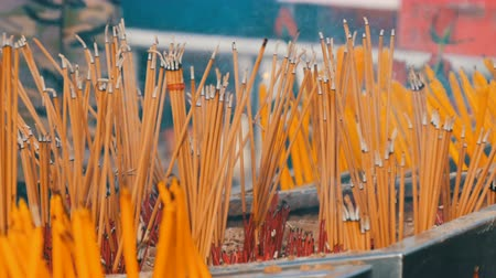 oltář : Large number of yellow sticks of good luck smoke in front of the altar. Religion Buddhism in Asian countries
