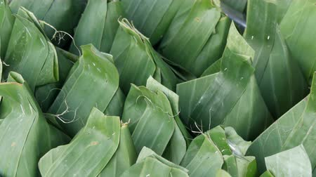 microonda : The products wrapped in banana leaves close up view Stock Footage