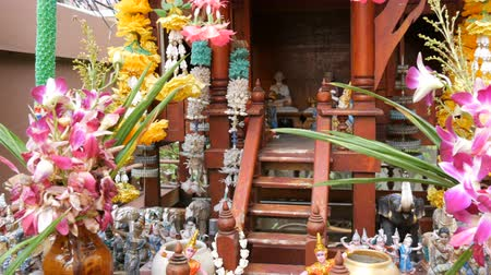 buddhista : Beautifully decorated traditional Buddhist altar in the garden in Thailand, with flowers and various symbolic figures