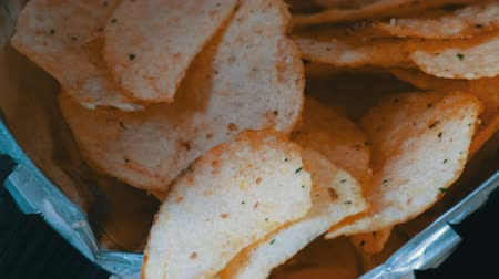 ведущий : Potato chips close up view on a table
