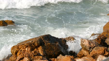 dalgakıran : Waves beat against the rocky shore. Beautiful waves of the South China Sea close up view