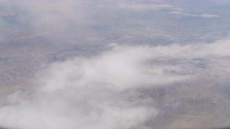 Тибет : Stunning beauty floats over desert mountain landscape. Top view from an airplane. Стоковые видеозаписи