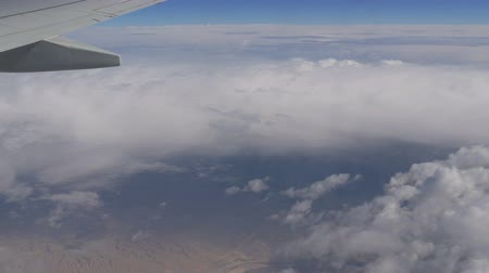 holy heaven : Variety of white fluffy clouds float across the sky, the view from the airplane