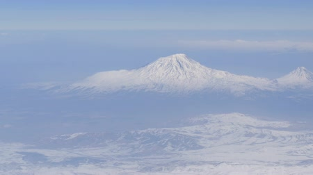 tampado : View of Mount Ararat from an airplane. Snow-capped mountain top. Biblical mount Ararat taken from the Airplane