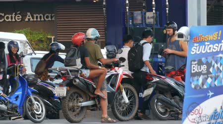 minibus : PATTAYA, THAILAND - DECEMBER 16, 2017: Motobikes and motorcycles are at gas station in the queue Stock Footage
