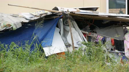 markiza : Old broken awning for poor people. Poor people live in dirty huts. The problem of the rich and poor in the world