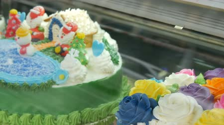 домовой : Tasty beautiful colorful cakes on a storefront. Decorated cakes are sold. Prolblem of diabetes and not healthy food