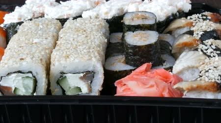 gunkan : Stylish fresh sushi set with various kinds of sushi rolls, close up
