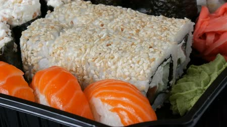 gunkan : Camera moves left from stylish fresh sushi set with various kinds of sushi rolls, close up