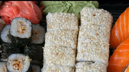 seafood dishes : Big sushi set with variety of sushi rolls, maki, nigiri, gunkan close up
