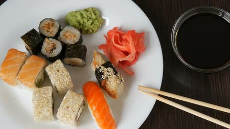 sake : A huge white dish with a variety of sushi rolls from the national Japanese cuisine
