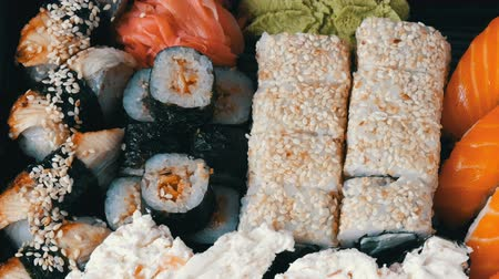 gunkan : Big sushi set with variety of sushi rolls, maki, nigiri, gunkan close up