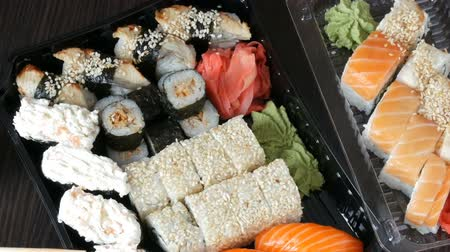 sake : Big sushi set with variety of sushi rolls, maki, nigiri, gunkan close up