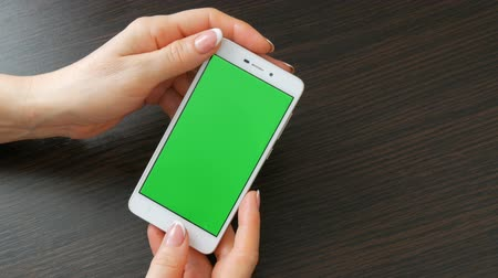 duplo : Female hands with beautiful French manicure take a white smartphone with Green Screen. Using Smartphone,Holding Smartphone with Green Screen