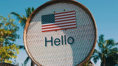 wooden type : Beautiful sign with American flag with the inscription Hello in English. Sign with the words hello Stock Footage