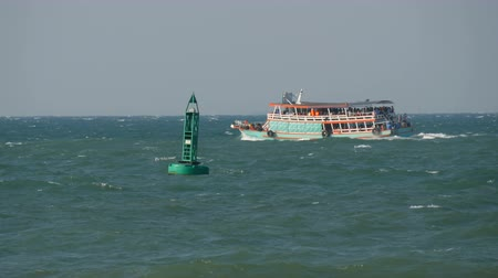 lifebelt : Blue buoy in the sea is sailing by a passenger ferry