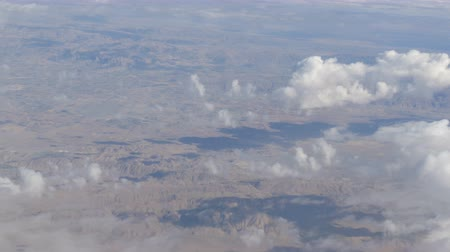 holy heaven : Mountain landscape with snow-capped peaks, view from airplane Stock Footage