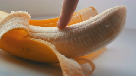 açıklık : Woman sexually touching with a finger of purified banana, macro close up view
