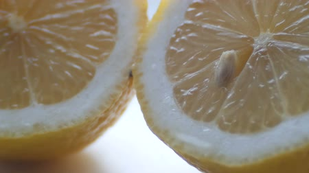 yarım uzunluk : Cut lemon macro close up view on white background Stok Video