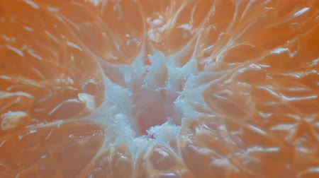 squeeze : Cut orange macro close up view on white background Stock Footage