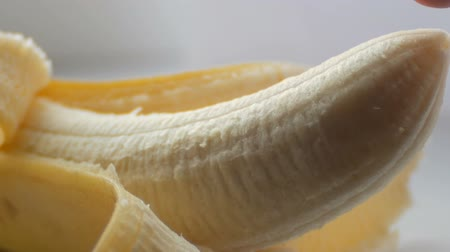 açıklık : Woman sexually touching with a finger top of purified banana, macro close up view Stok Video