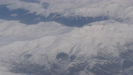 jet ski : Aerial and video shooting of snow-capped Caucasian mountains from the airplane Stock Footage