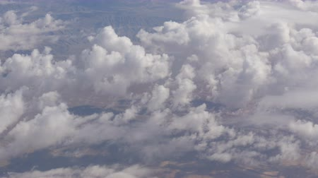 stratosfer : Stunning beauty floats over desert mountain landscape. Top view from an airplane. Stok Video