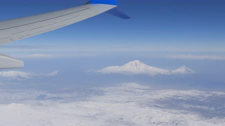 библейский : View of Mount Ararat from an airplane. The wing of the plane and snow-capped mountain top. Biblical mount Ararat taken from Airplane