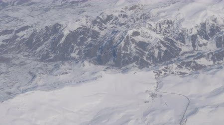biggest : Aerial and video shooting of snow-capped Caucasian mountains from the airplane Stock Footage