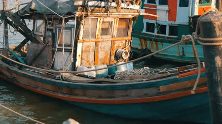 industrial fishing : Old wooden half-ruined and wrecked ship is moored on a fishing dock Stock Footage