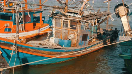 fishermen : Old wooden half-ruined and wrecked ship is moored on a fishing dock Stock Footage